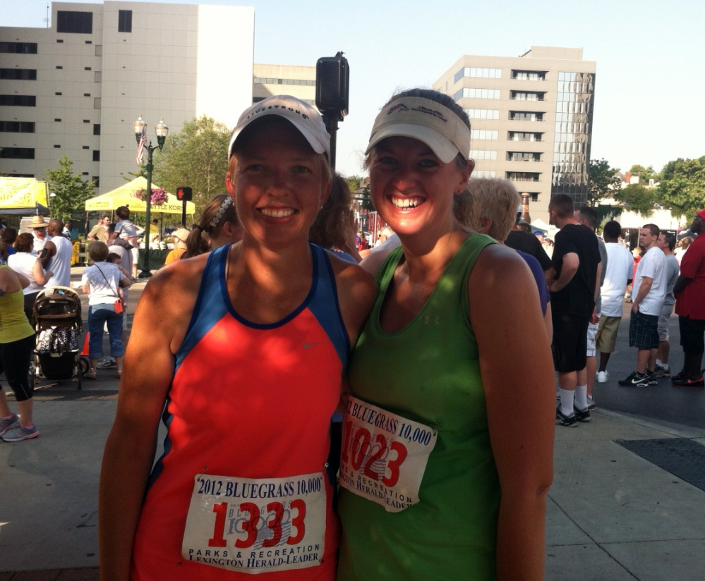 Melanie and I after finishing the Bluegrass 10K--hot, sweaty, but happy!
