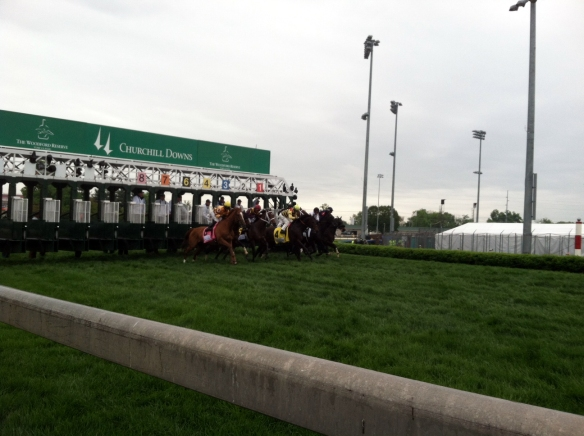 THe field breaks from the gate for the Woodford Reserve Turf Classic, the race before the Kentucky Derby