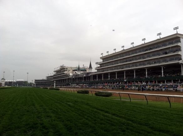 Churchill Downs grandstand from the final turn of the track on a gloomy day.