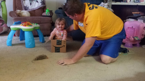 "Fun times with daddy: Playing ""boat"" with a box from your Christmas presents."