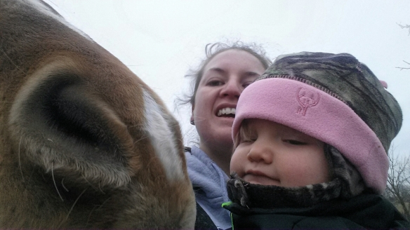 Giving Lark a kiss before we turn her out for the day. I hope you become a horsewoman like your momma.
